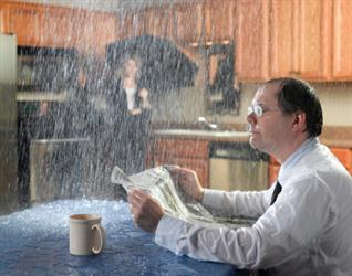 People in need of roof repair in Crofton MD. Leaky roof causing it to rain on people in their kitchen. Humorous.